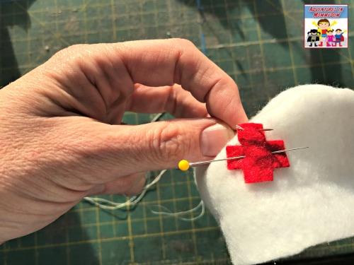 world war 1 nurse's hat sewing on red cross